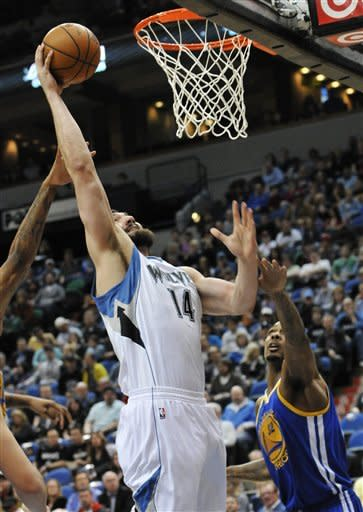 Minnesota Timberwolves' Nikola Pekovic goes up for a dunk as Golden State Warriors' Mickell Gladness defends during the first half of an NBA basketball game Sunday, April 22, 2012, in Minneapolis. (AP Photo/Jim Mone)