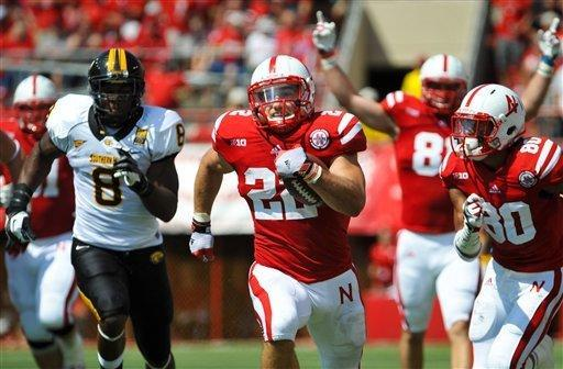 Nebraska's Rex Burkhead (22) gets past Southern Mississippi's Jamie Collins (8) for a 57-yard touchdown run in the first quarter of an NCAA college football game, Saturday, Sept 1, 2012, in Lincoln, Neb. (AP Photo/Dave Weaver)