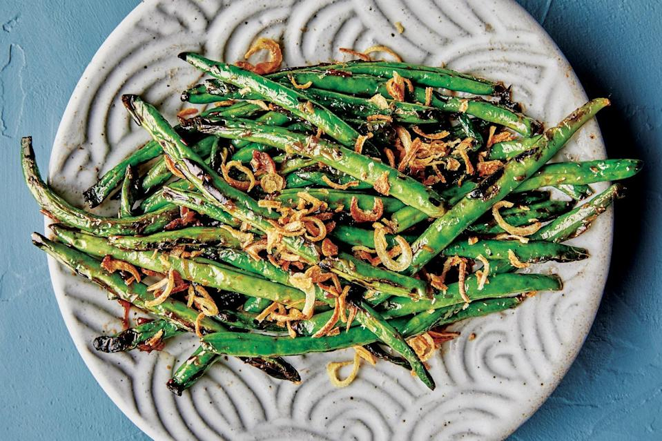 "Crispy fried shallots complete this dish. And they don't even need to be homemade. The folks at <a href=""https://unionkitchenmn.com/"" rel=""nofollow noopener"" target=""_blank"" data-ylk=""slk:Union Hmong Kitchen"" class=""link rapid-noclick-resp"">Union Hmong Kitchen</a> in Minneapolis swear by the big jars of <a href=""https://www.amazon.com/Maesri-Fried-Shallot-8-8-Ounce/dp/B00L2A4MLA"" rel=""nofollow noopener"" target=""_blank"" data-ylk=""slk:fried shallots"" class=""link rapid-noclick-resp"">fried shallots</a> available at Asian markets and online, but any kind of fried onion will work. <a href=""https://www.bonappetit.com/recipe/crispy-fried-shallots?mbid=synd_yahoo_rss"" rel=""nofollow noopener"" target=""_blank"" data-ylk=""slk:Here's a recipe"" class=""link rapid-noclick-resp"">Here's a recipe</a> if you want to make your own. <a href=""https://www.bonappetit.com/recipe/blistered-green-beans-with-fried-shallots?mbid=synd_yahoo_rss"" rel=""nofollow noopener"" target=""_blank"" data-ylk=""slk:See recipe."" class=""link rapid-noclick-resp"">See recipe.</a>"
