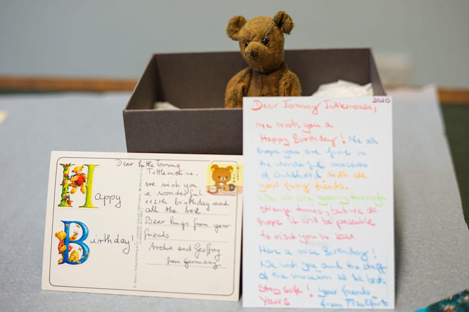 Secrets of the Museum S2 - Little Tommy Tittlemouse, sat in a box, with two postcards wishing him a happy birthday. (BBC/Blast! Films)