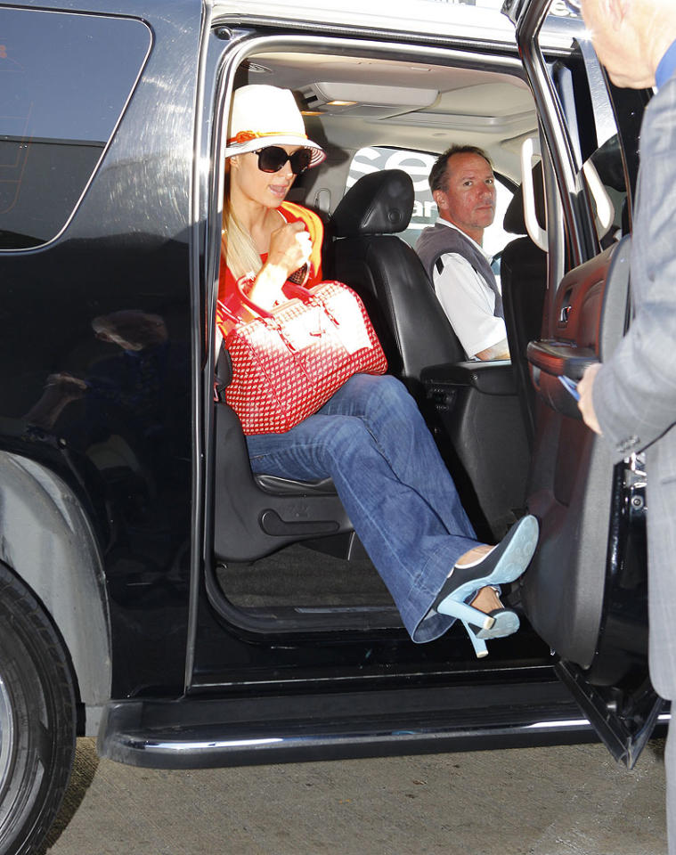 Hotel heiress Paris Hilton and her younger sister Nicky made their way through LAX on Monday. The two were headed to Miami to attend the Winter Music Conference, a 10-day extravaganza of concerts, workshops, and parties that continues through March 25. (3/19/2012)