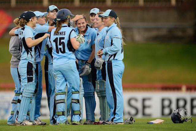 SYDNEY, AUSTRALIA - FEBRUARY 16: Players of NSW celebrate after winning the WNCL Final match between NSW and Victoria on February 16, 2014 in Sydney, Australia. (Photo by Brett Hemmings/Getty Images)
