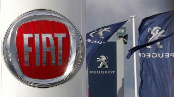PHOTO: The logos of car manufacturers Fiat and Peugeot are seen in front of dealerships of the companies in Saint-Nazaire, France, Nov. 8, 2019. (Stephane Mahe/Reuters, FILE)