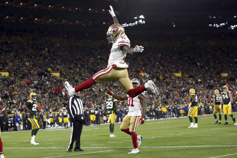 San Francisco 49ers wide receiver Marquise Goodwin (11) celebrates a touchdown during the first half of an NFL football game against the Green Bay Packers Monday, Oct. 15, 2018, in Green Bay, Wis. (AP Photo/Matt Ludtke)