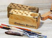 """<p><strong>GiftWoods</strong></p><p>etsy.com</p><p><strong>$42.00</strong></p><p><a href=""""https://go.redirectingat.com?id=74968X1596630&url=https%3A%2F%2Fwww.etsy.com%2Flisting%2F847790650%2Fpaint-brush-holder-7-personalize-made-of&sref=https%3A%2F%2Fwww.goodhousekeeping.com%2Fholidays%2Fgift-ideas%2Fg29589435%2Fbest-gifts-for-artists%2F"""" rel=""""nofollow noopener"""" target=""""_blank"""" data-ylk=""""slk:Shop Now"""" class=""""link rapid-noclick-resp"""">Shop Now</a></p><p>By personalizing this wooden brush or supplies holder with their name and yours, it'll serve as a daily reminder that you cosign their greatest passion.</p>"""