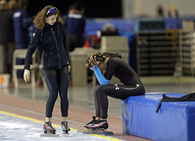 First-place finisher Maria Lamb, left, skates up to second-place finisher Petra Acker after competing in the women's 5,000 meters during the U.S. Olympic speedskating trials Wednesday, Jan. 1, 2014, in Kearns, Utah. (AP Photo/Rick Bowmer)