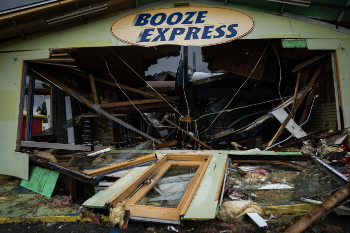 <p>A Booze Express is seen damaged after category 4 Hurricane Michael made land fall along the Florida panhandle, on Wednesday, Oct. 10, 2018 in Panama City Beach, Fla. (Photo: Jabin Botsford/The Washington Post via Getty Images) </p>