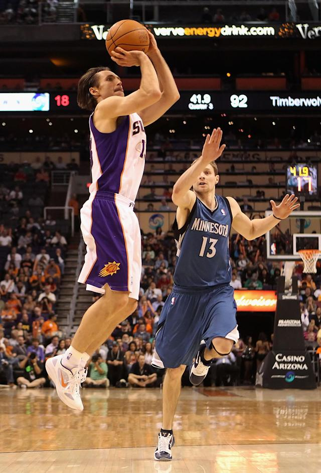 PHOENIX, AZ - MARCH 12: Steve Nash #13 of the Phoenix Suns puts up a shot past Luke Ridnour #13 of the Minnesota Timberwolves during the NBA game at US Airways Center on March 12, 2012 in Phoenix, Arizona. The Timberwolves defeated the Suns 127-124. NOTE TO USER: User expressly acknowledges and agrees that, by downloading and or using this photograph, User is consenting to the terms and conditions of the Getty Images License Agreement. (Photo by Christian Petersen/Getty Images)