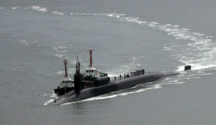 The nuclear-powered submarine USS Michigan joins aircraft carrier USS Carl Vinson in drills near the Korean Peninsula at Busan (Picture: AP)