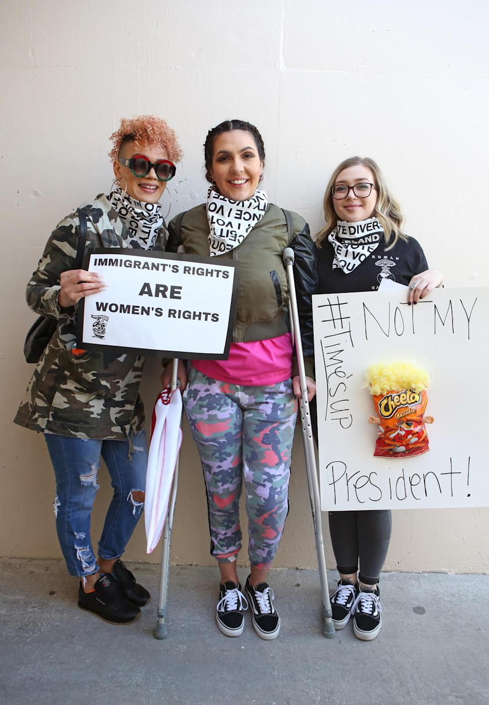 """<p>From left: Jasmine Mejia, Jessica Walter, and Samantha Leslie came together from Las Vegas. """"We've got to come together; it doesn't matter if you're injured,"""" says Walter, who has a dislocated knee. Leslie says, """"I'm here to support all women, to support Planned Parenthood, and the fact that we've come so far and are now at a stalemate."""" (Photo: Ronda Churchill for Yahoo Lifestyle) </p>"""
