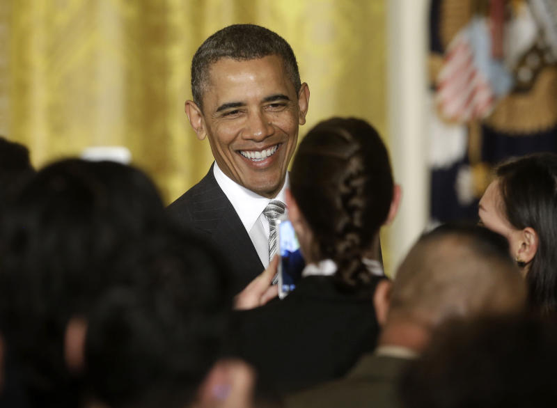 Obama calls for April debate on immigration bill