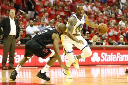 May 14, 2018; Houston, TX, USA; Golden State Warriors forward Andre Iguodala (9) drives against Houston Rockets guard Chris Paul (3) during the fourth quarter in game one of the Western conference finals of the 2018 NBA Playoffs at Toyota Center. Mandatory Credit: Troy Taormina-USA TODAY Sports