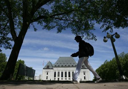 A woman walks past the Supreme Court of Canada in Ottawa
