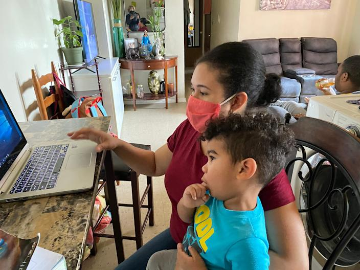 Marleny Hernandez often studied for her final exams with 2-year-old Jayce on her lap.