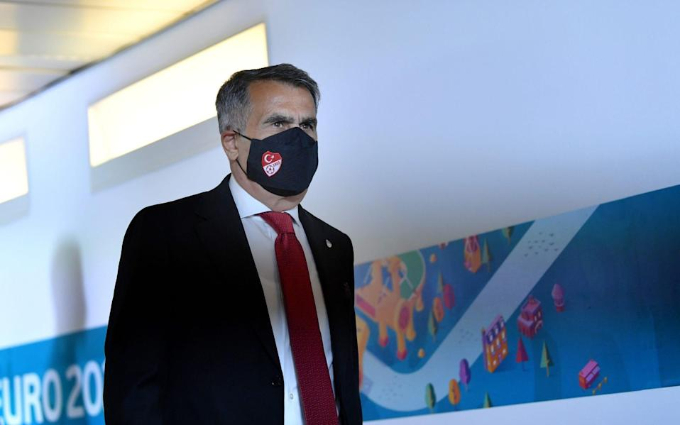 Head Coach of Turkey is seen wearing a face covering - Getty Images