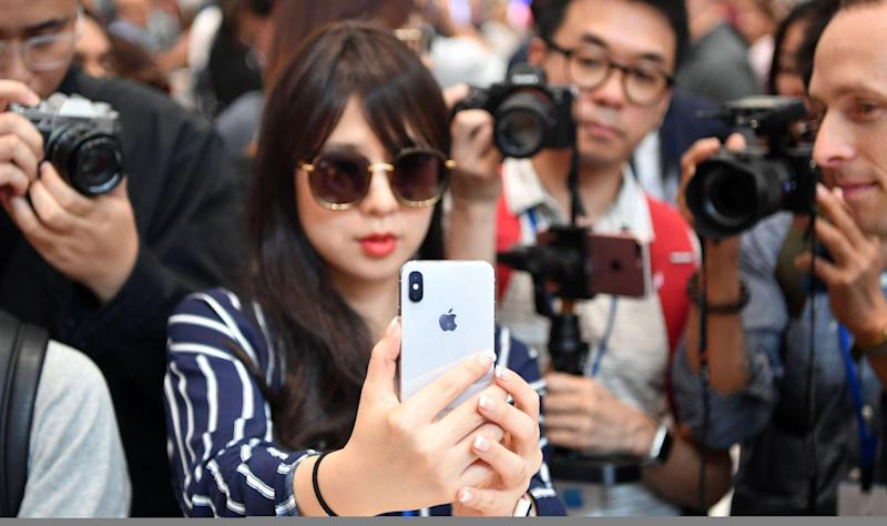 People take photos as a woman tests out a new iPhone X during a media event at Apple's new headquarters in Cupertino, California on September 12, 2017: JOSH EDELSON/AFP/Getty Images