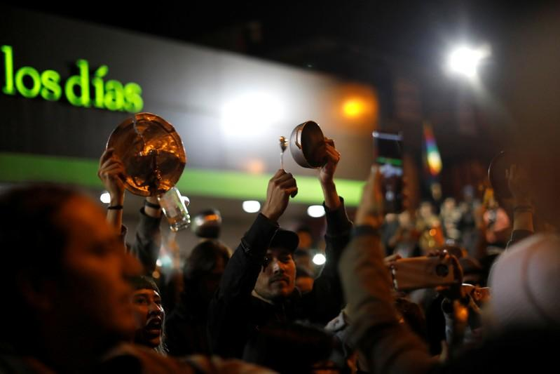Demonstrators bang pots as they join a call for what they say is a simultaneous cacerolazos throughout Latin America in support of protests, in Bogota