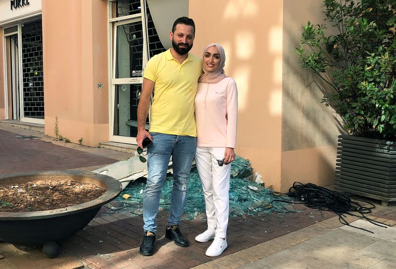 Bride Israa Seblani poses for a picture with her husband Ahmad Subeih in Beirut