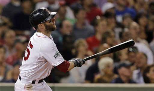 Boston Red Sox's Dustin Pedroia watches the flight of his three-run home run off Los Angeles Angels pitcher C.J. Wilson during the second inning of a baseball game at Fenway Park in Boston, Thursday, Aug. 23, 2012. (AP Photo/Charles Krupa)