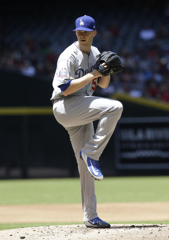 File-This May 3, 2018, file photo shows Los Angeles Dodgers starting pitcher Alex Wood (57) in the first inning of a baseball game against the Arizona Diamondbacks in Phoenix. Trevor Bauer, Gerrit Cole and Wood have won their salary arbitration cases, giving players a 6-3 advantage over teams to ensure a winning record in consecutive years for the first time since 1979-81. Wood will get $9.65 million instead of the Cincinnati Reds $8.7 million offer, Dan Brent, Andrew Strongin and Phillip LaPorte decided. (AP Photo/Rick Scuteri, File)