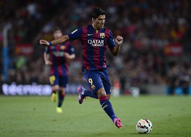 Barcelona's Uruguayan forward Luis Suarez plays during the 49th Joan Gamper Trophy match against Leon Club at the Camp Nou stadium in Barcelona on August 18, 2014 (AFP Photo/Josep Lago)