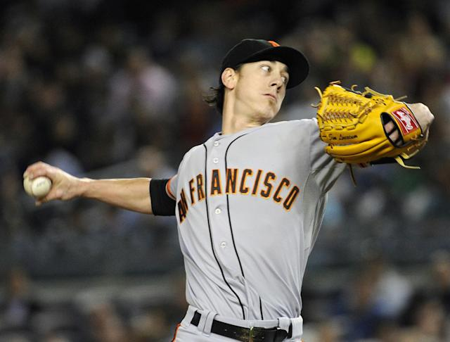 San Francisco Giants pitcher Tim Lincecum delivers the ball during the first inning of an interleague baseball game against the New York Yankees, Friday, Sept. 20, 2013, at Yankee Stadium in New York. (AP Photo/Bill Kostroun)