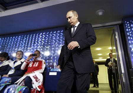 Russian President Putin walks out from the presidential lounge to take his seat as he is introduced during the closing ceremony for the 2014 Sochi Winter Olympics
