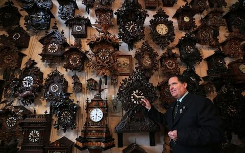 Horologist Roman Piekarski adjusting the antique clocks at Cuckooland Museum in Tabley - Credit: Lynne Cameron/PA Wire