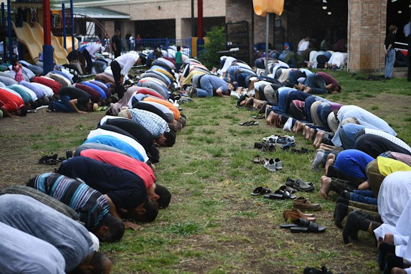 Worshippers pray in Stafford, Texas, during the funeral service of Santa Fe High School shooting victim Sabika Sheikh, 17, on May, 20, 2018.  (BRENDAN SMIALOWSKI via Getty Images)