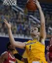 Michigan center Hunter Dickinson (1) makes a layup during the second half of the team's NCAA college basketball game against Wisconsin, Tuesday, Jan. 12, 2021, in Ann Arbor, Mich. (AP Photo/Carlos Osorio)