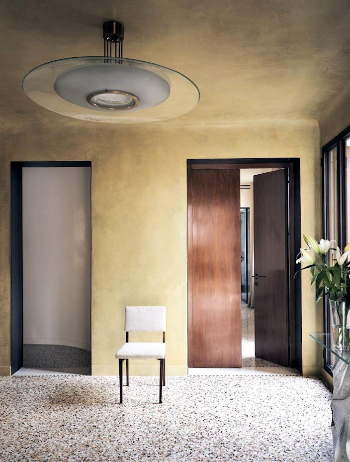 """<p>A tried-and-true trick to making a dark space feel brighter is to fill it with the colors of the sun, like reds, yellows, and oranges. <em>ED</em> A-List designer Jaques Grange covered the walls in this <a href=""""https://www.elledecor.com/design-decorate/house-interiors/a31976615/venice-grand-canal-jacques-grange/"""" rel=""""nofollow noopener"""" target=""""_blank"""" data-ylk=""""slk:Venice apartment"""" class=""""link rapid-noclick-resp"""">Venice apartment</a> with custom Marmorino Venetian plaster. </p>"""