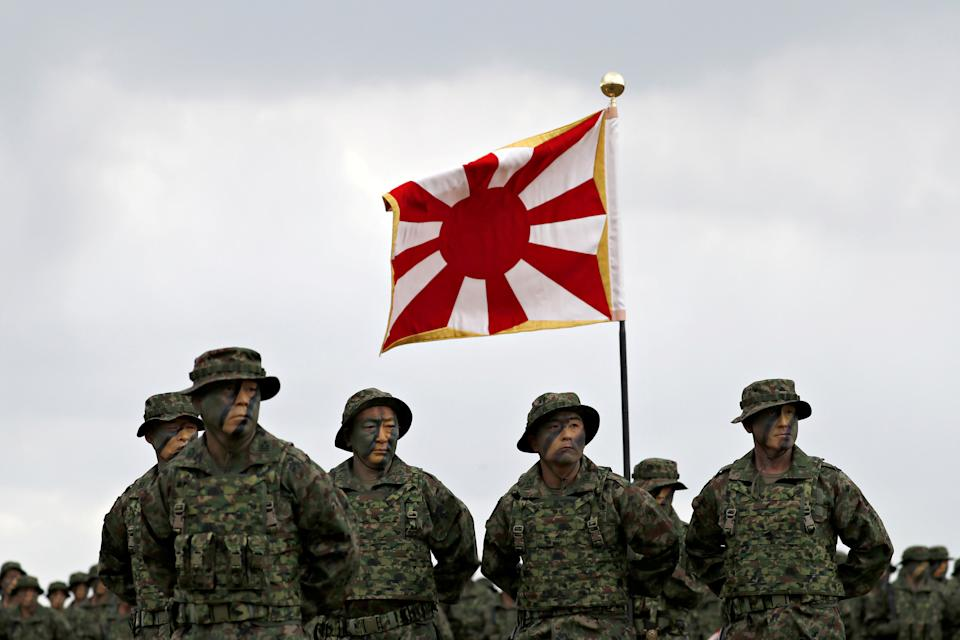 Soldiers of Japanese Ground Self-Defense Force (JGSDF)'s Amphibious Rapid Deployment Brigade, Japan's first marine unit since World War Two, gather at a ceremony activating the brigade at JGSDF's Camp Ainoura in Sasebo