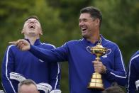 Team Europe captain Padraig Harrington and Team Europe's Matt Fitzpatrick smile as they pose for a team picture during a practice day at the Ryder Cup at the Whistling Straits Golf Course Tuesday, Sept. 21, 2021, in Sheboygan, Wis. (AP Photo/Charlie Neibergall)