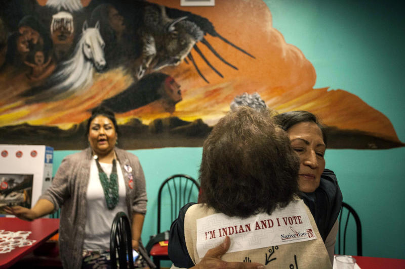New Mexico congressional candidate Deb Haaland embraces a supporter during her visit to the Albuquerque Indian Center for the Native Vote Celebration in Albuquerque, New Mexico midterms election night Tuesday, Nov. 6, 2018. Haaland and Kansas Democrat Sharice Davids were elected the first two Native American women to serve in Congress. (AP Photo/Juan Labreche)