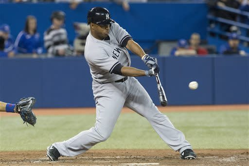 New York Yankees' Vernon Wells hits a single to load the bases against Toronto Blue Jays during the fifth inning of a baseball game in Toronto on Saturday, April 20, 2013. (AP Photo/The Canadian Press, Chris Young