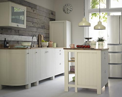 """<b>Pimp your splashback</b><br><br>When it comes to splashbacks, think beyond tile and glass. Here, a <a href=""""http://www.marksandspencer.com/Marks-and-Spencer-Fenchurch-Pull-Out/dp/B0058098GO"""" rel=""""nofollow noopener"""" target=""""_blank"""" data-ylk=""""slk:wood-look wall"""" class=""""link rapid-noclick-resp"""">wood-look wall</a> adds interest to this Fenchurch kitchen from Marks & Spencer. <br><br>Pimp Your Kitchen can create a <a href=""""http://www.pimpyourkitchen.co.uk/pimpyourkitchen-fabulous-splashback-design-for-your-kitchen.html"""" rel=""""nofollow noopener"""" target=""""_blank"""" data-ylk=""""slk:splash back"""" class=""""link rapid-noclick-resp"""">splash back</a> from an image of your choice – whether a family photo or favourite scene. Supply them with a close-up of a rough texture, such as tree bark, for something that's unique and practical too."""