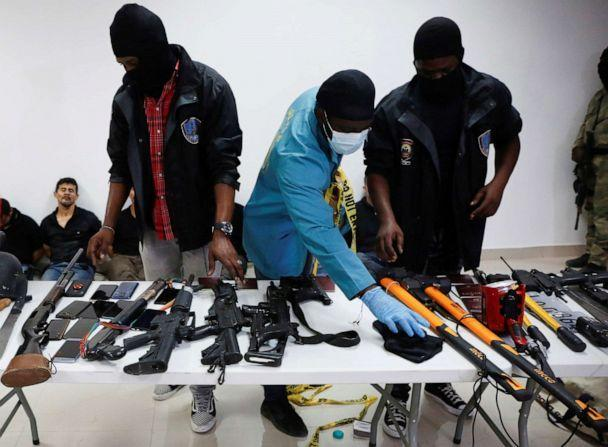 PHOTO: Weaponry, mobile phones, passports and other items are being shown to the media along with alleged suspects in the assassination of President Jovenel Moise, in Port-au-Prince, Haiti July 8, 2021. (Estailove St-Val/Reuters)