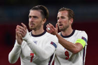 England's Harry Kane and Jack Grealish, left, applaud the supporters at the end of the Euro 2020 soccer championship group D match between the Czech Republic and England at Wembley stadium in London, Tuesday, June 22, 2021. England won 1-0. (Justin Tallis, Pool photo via AP)