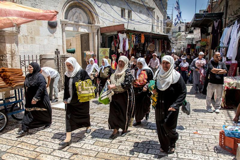 Muslim women from nearby villages on their way to noon prayer at Al-Aqsa Mosque during the Islamic holy month of Ramadan.