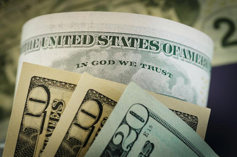 The writing ' In God we trust ' is seen on a dollar bill on August 14, 2015, in Berlin, Germany. (Photo: Thomas Trutschel/Photothek via Getty Images)