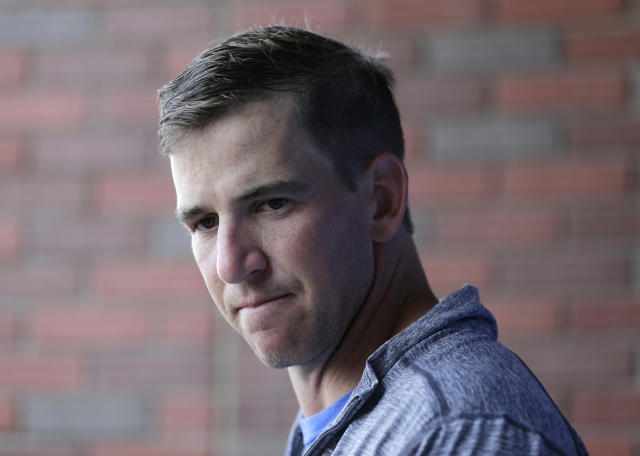 New York Giants quarterback Eli Manning talks to reporters after NFL football practice in East Rutherford, N.J., Tuesday, June 13, 2017. (AP Photo/Seth Wenig)