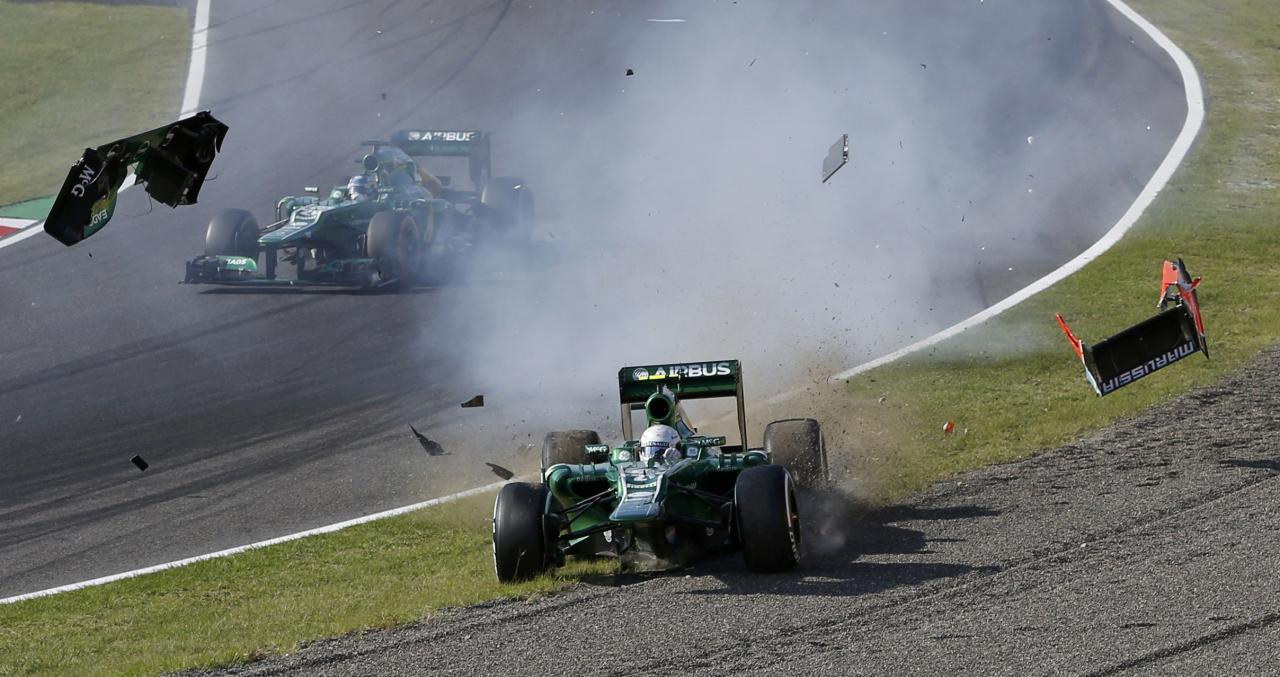 Caterham Formula One driver Giedo van der Garde of Netherlands crashes after colliding with Marussia Formula One driver Jules Bianchi of France during the Japanese F1 Grand Prix at the Suzuka circuit October 13, 2013. REUTERS/Issei Kato (JAPAN - Tags: SPORT MOTORSPORT F1 TPX IMAGES OF THE DAY)