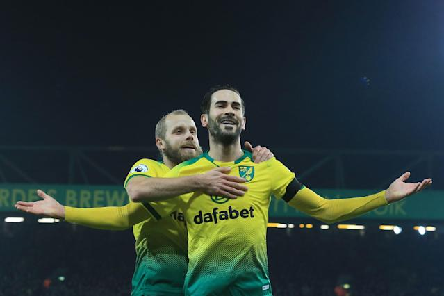 Norwich City's Bosnian midfielder Mario Vrancic celebrates scoring the opening goal with Finnish striker Teemu Pukki. (Photo by LINDSEY PARNABY/AFP via Getty Images)