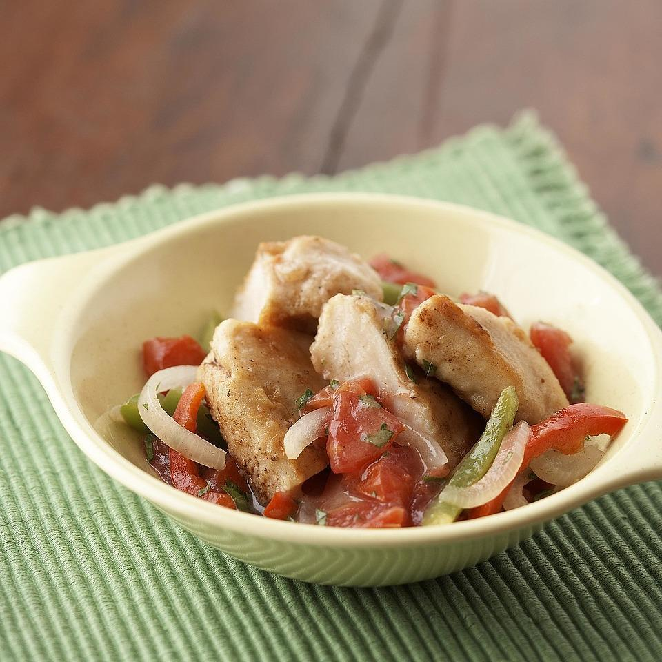 """<p>A zesty low-calorie tomato, sweet pepper and garlic sauce dresses up succulent quick-fried chicken. <a href=""""http://www.eatingwell.com/recipe/265435/chicken-pepper-saute/"""" rel=""""nofollow noopener"""" target=""""_blank"""" data-ylk=""""slk:View recipe"""" class=""""link rapid-noclick-resp""""> View recipe </a></p>"""