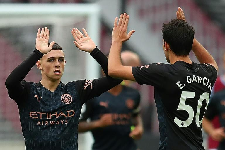 Manchester City midfielder Phil Foden (left) celebrates his equaliser against West Ham