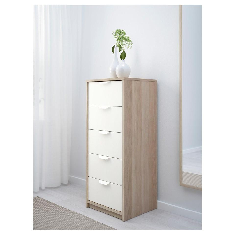 <p>Tall and narrow, the <span>Askvoll Five Drawer Chest </span> ($79) can hold all of your belongings without taking up tons of space.</p>