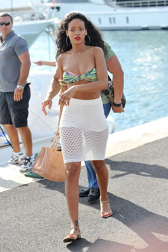 Rihanna is another star attracted to the sun and fun of St. Tropez. The pop star and her friends had a blast while getting some R&R in the French Riviera. Of course, RiRi managed to fit in lots of shopping as well ... and even while wearing this baring ensemble!<br>