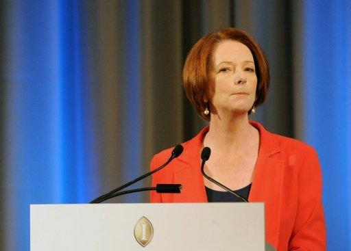 """Within a month we would hope to see people processed on Nauru and Papua New Guinea,"" Australian Prime Minister Julia Gillard, pictured on August 7, said, adding that she had spoken to the leaders of both nations and they responded positively to the idea"
