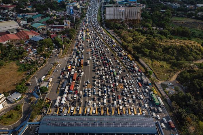 An aerial view of traffic at North Luzon Expressway hours before Manila is placed on lockdown, on March 14 in the outskirts of Metro Manila, Philippines.