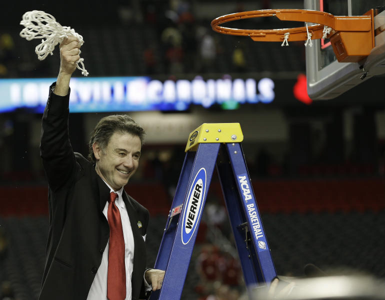 Louisville head coach Rick Pitino celebrates after the team defeated Michigan 82-76 during the NCAA Final Four tournament college basketball championship game, Monday, April 8, 2013, in Atlanta. (AP Photo/David J. Phillip)